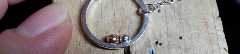 cropped-encircled-beads-on-peg.jpg