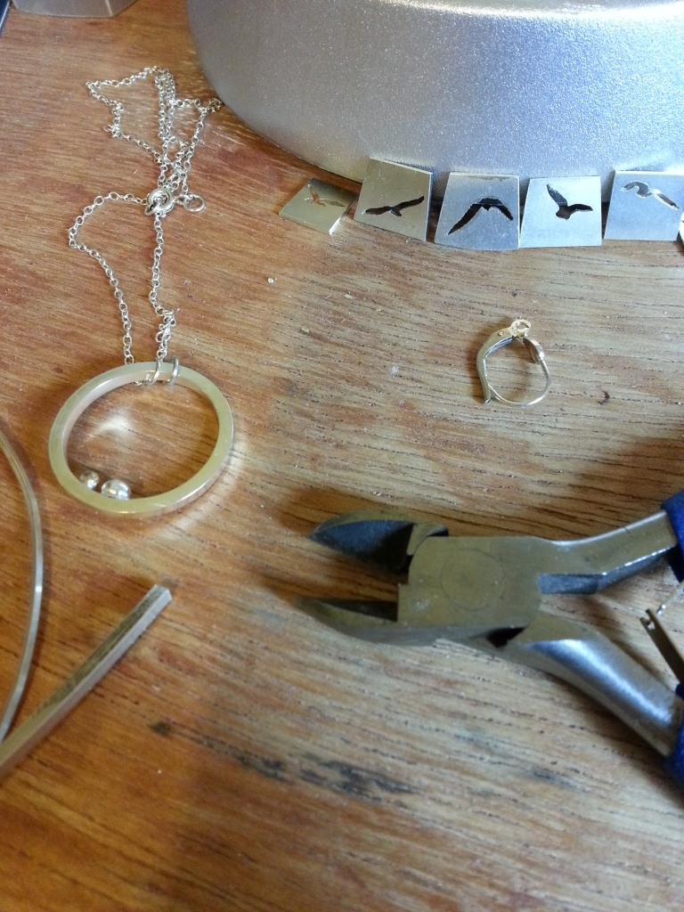 Tools and jewellery work-in-progress on the bench
