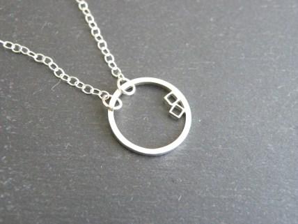 Encircled squares pendant