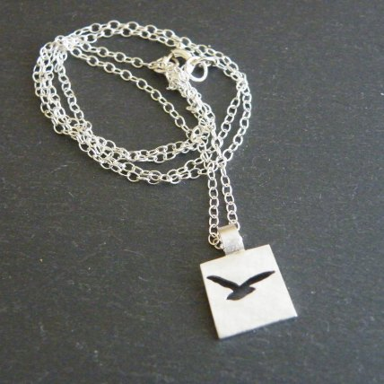 Bird silhouette pendant